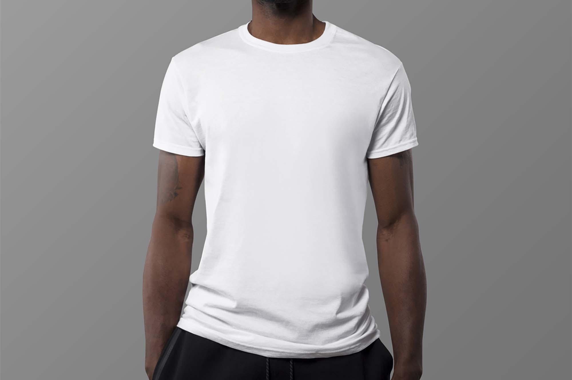 Mockup of Man Wearing White T-Shirt
