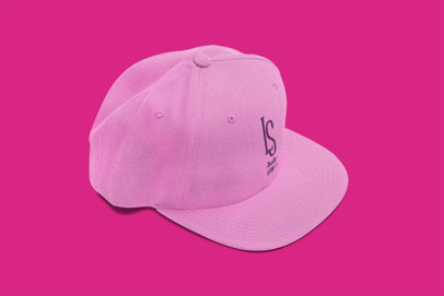 Fitted Hat on a Solid Color Surface Mockup